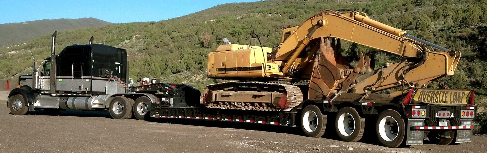 Semi hauling construction equipment